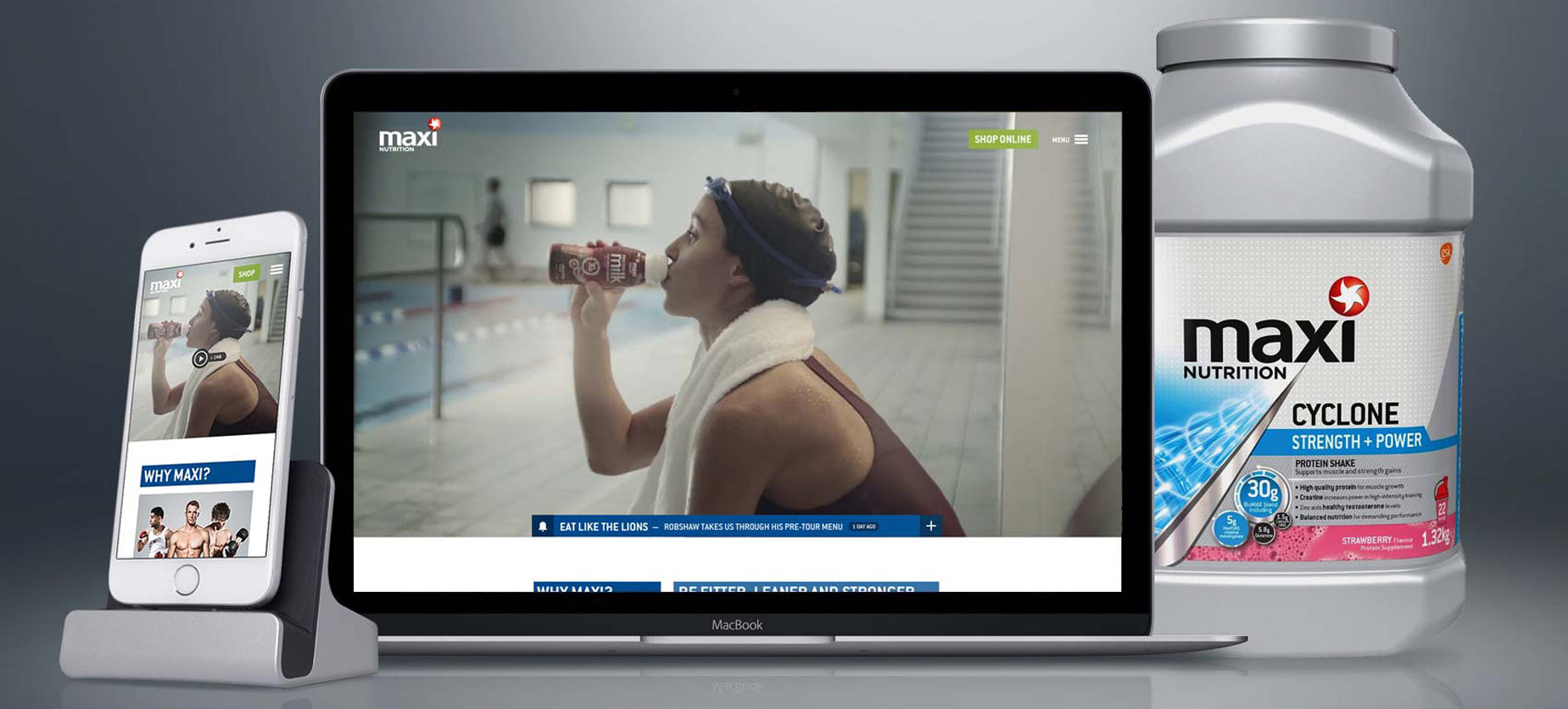 MaxiNutrition website on MacBook and iPhone next to product