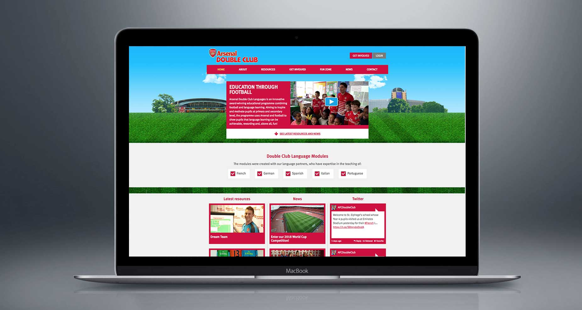 Arsenal double club website on a Macbook