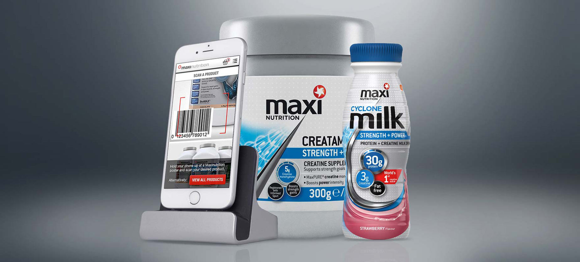 MaxiNutrition website on an iPhone next to MaxiNutrition products