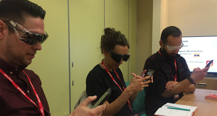The UX team with visual impairment glasses on