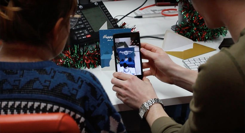 Friends react to the Augmented Reality Christmas card